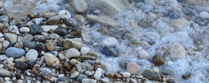 Water over pebbles on a beach